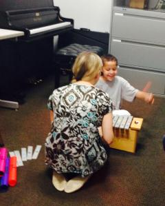 My oldest having a blast on the xylophone at music therapy!