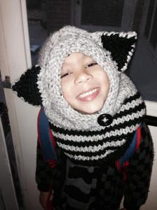 My youngest with this knitted raccoon hoodie.