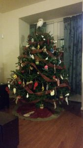 This year's tree has a bird theme-- with a wise owl on top and about 50 handmade ornaments by yours truly!